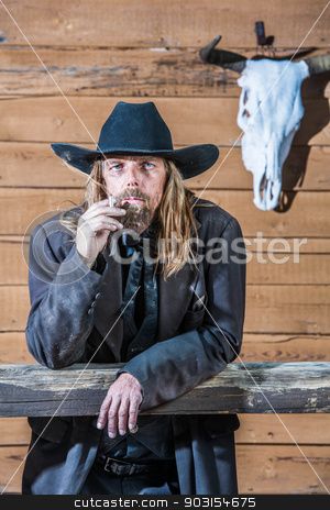 Bandit Portrait stock photo, Portrait of a gruff looking old west bandit by Scott Griessel