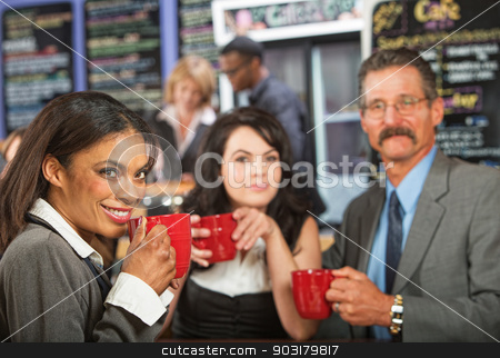 Cheerful Business People in Cafe stock photo, Three cheerful business people meeting at indoor cafe by Scott Griessel