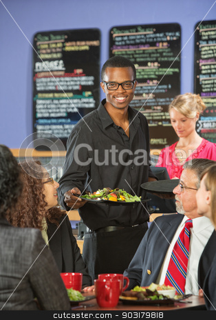 Serving Customers Food stock photo, Smiling handsome cafe waiter bringing customers food by Scott Griessel