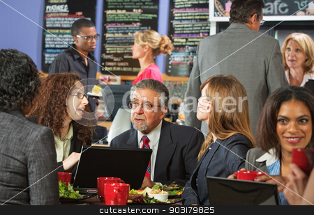 Lunch Break with Workers stock photo, White collar workers with laptop in cafeteria by Scott Griessel