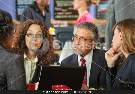 Business Man and Women in Cafe stock photo, Business people at a power lunch with laptop by Scott Griessel