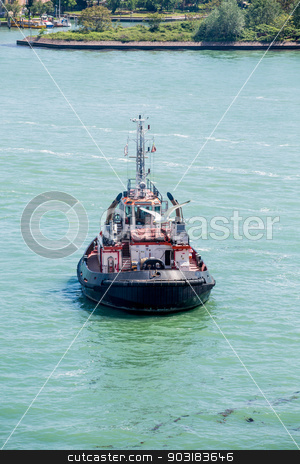 Old Tugboat in Green Canal Water stock photo, An old tugboat in the deep green water of a Venice canal by Darryl Brooks