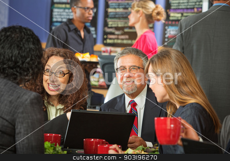 Business People at Lunch stock photo, Diverse group of business people meeting at indoor cafe by Scott Griessel