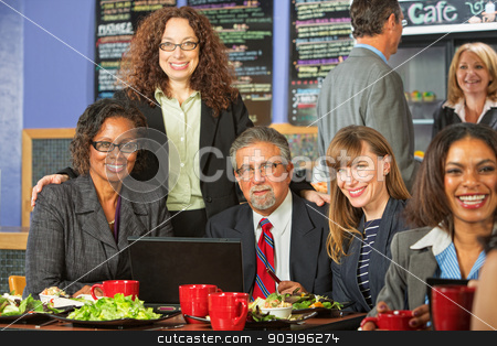 Happy Coworkers at Lunch stock photo, Happy diverse group of business people meeting for lunch by Scott Griessel