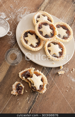 Eating tasty home baked Christmas mince pies stock photo, Eating tasty home baked Christmas mince pies freshly baked in a rustic kitchen and decorated with pastry stars by Stephen Gibson