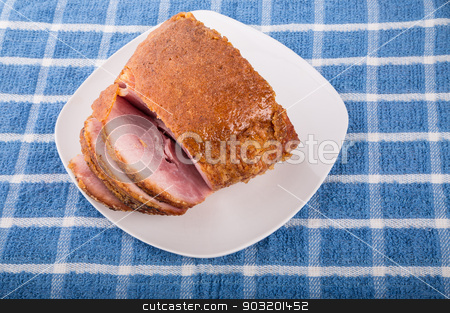 Honey Baked Ham Sliced on White Plate stock photo, Fresh Ham baked with sweet honey crust by Darryl Brooks
