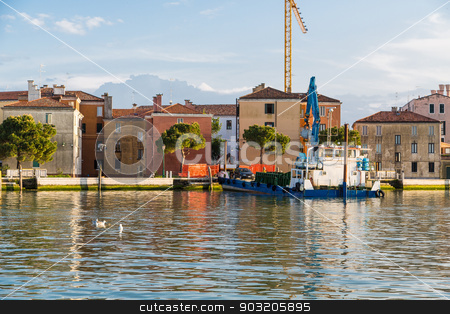 Car Loading onto Ferry in Venice stock photo, An old ferry in a Venice canal with car driving onto rear by Darryl Brooks