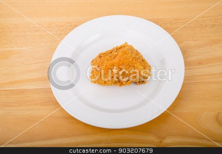 Chicken Thigh on White Plate stock photo, A piece of fresh, crunchy fried chicken on a white plate by Darryl Brooks