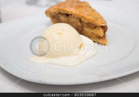 Apple Pie and Vanilla Bean Ice Cream stock photo, A slice of fresh apple pie with a scoop of vanilla bean ice cream on a white plate by Darryl Brooks