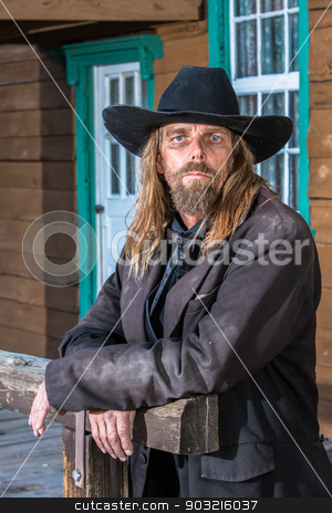 Bandit Portrait stock photo, Portrait of a gruff looking old west bandit by Scott Griessel