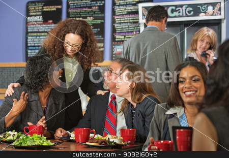 Friends Joking During Lunch stock photo, Diverse group of mature friends laughing during lunch by Scott Griessel