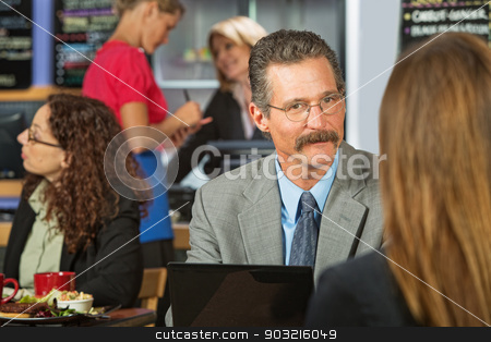 Man Listening to Woman stock photo, Executive with mustache listening to woman in cafe by Scott Griessel