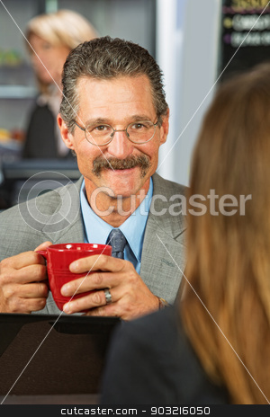 Happy Businessman stock photo, Happy businessman with coffee talking with woman by Scott Griessel