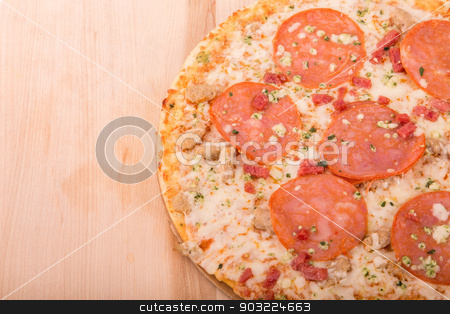 Pepperoni Pizza on Wood Cutting Board with Copy Space stock photo, Ahot cheesy pepperoni pizza on a wood cutting board with room for copy space by Darryl Brooks
