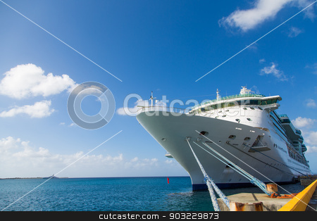 Yellow Curb on Pier by White Cruise Ship stock photo, Luxury Cruise Ship Anchored Under Nice Skies at Harbor on St Croix by Darryl Brooks