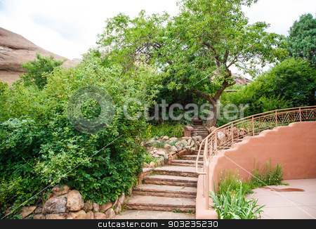 Stone Steps Curving by Green Trees stock photo, A stone and adobe staircase through a natural landscaped garden by Darryl Brooks