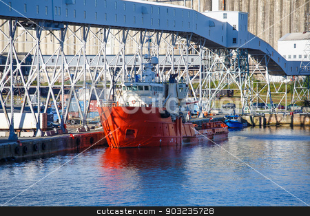 Orange and White Industrial Ship stock photo, An orange and white industrial ship in Halifax harbor by Darryl Brooks