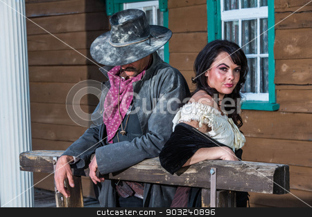 Gruff Man and Woman stock photo, Portrait of a woman and sheriff by Scott Griessel