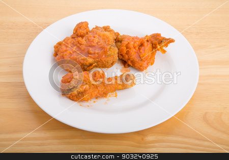 Hot Buffalo Style Fried Chicken stock photo, A plate of hot, crispy fried chicken with hot, spicy buffalo style sauce by Darryl Brooks