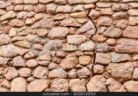 Old Cracked Stone Wall stock photo, An old stone wall with a crack running through it by Darryl Brooks