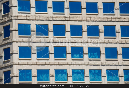 Square Blue Windows in Stone Building stock photo, Square windows in a stone building reflecting blue skies by Darryl Brooks