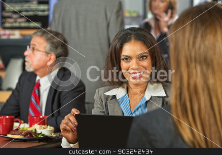Woman in Cafe with Laptop stock photo, Smiling beautiful business woman with friend in cafe by Scott Griessel
