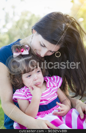 Loving Mother Consoles Crying Baby Daughter stock photo, Mixed Race Loving Mother Consoles Her Crying Baby Daughter in Park. by Andy Dean