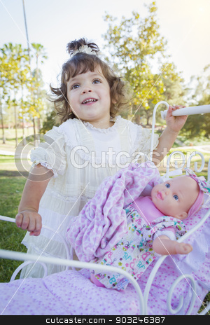 Adorable Young Baby Girl Playing with Baby Doll and Carriage stock photo, Adorable Young Baby Girl Playing with Her Baby Doll and Carriage Outdoors. by Andy Dean