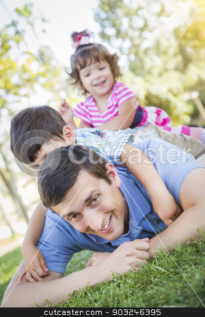 Young Son and Daughter Having Fun With Their Dad Outdoors stock photo, Young Son and Baby Daughter Having Fun With Their Dad Outdoors. by Andy Dean