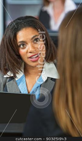 Amazed Business Woman stock photo, Amazed Black woman talking with friend in restaurant by Scott Griessel