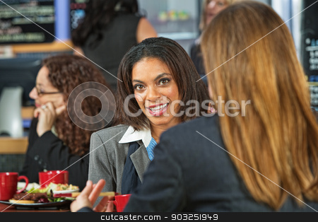 Happy Executive Female stock photo, Happy female executives talking in a coffee house by Scott Griessel
