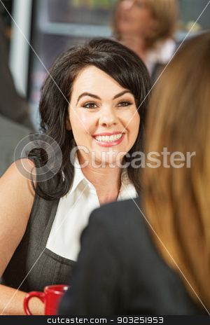 Smiling Woman in Restaurant stock photo, Smiling European business woman in restaurant with friend by Scott Griessel
