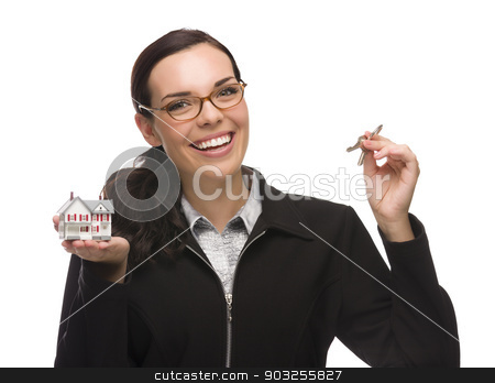 Mixed Race Female Presenting Keys and Holding a Small House stock photo, Mixed Race Female Presenting House Keys Holding a Small House Isolated on White Background. by Andy Dean