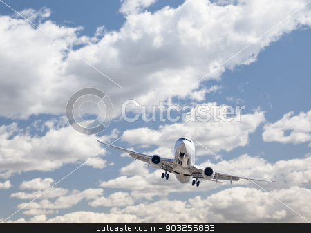 Jet Airplane Landing with Dramatic Clouds Behind stock photo, Jet Airplane Landing with Dramatic Clouds and Sky Behind. by Andy Dean