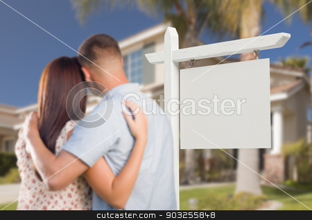 Blank Real Estate Sign and Military Couple Looking at House stock photo, Blank Real Estate Sign and Military Couple Looking at Nice New House. by Andy Dean