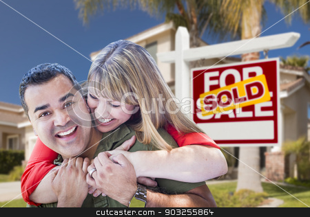 Couple in Front of Sold Real Estate Sign and House stock photo, Happy Hugging Mixed Race Couple in Front of Sold Home For Sale Real Estate Sign and House. by Andy Dean