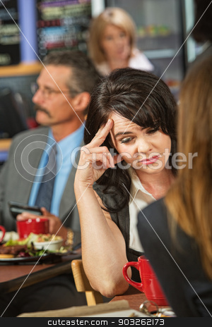 Sorry Woman stock photo, Sorry female sitting with friend in coffee house by Scott Griessel