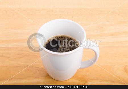 Half Cup of Black Coffee on Wood Table stock photo, A cup of black coffee on a wood table by Darryl Brooks