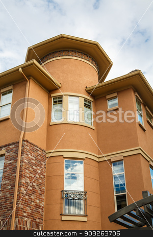 Round Condo Building stock photo, A plaster condo building with a round tower in corner by Darryl Brooks