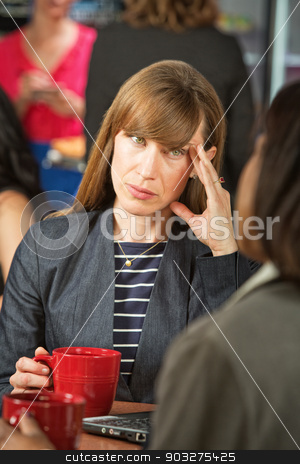 Annoyed Woman on Break stock photo, Annoyed business woman with coffee talking with coworker by Scott Griessel