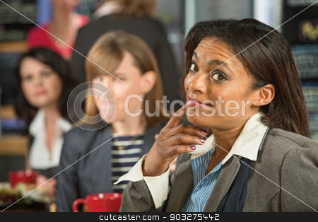 Lady with Raised Eyebrows stock photo, Black business woman with jealous coworker in cafeteria by Scott Griessel