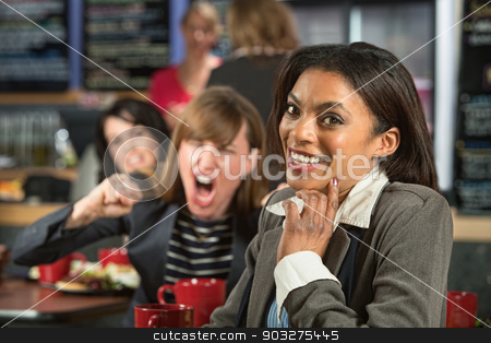 Giggling Woman stock photo, Angry lady behind giggling woman in coffee house by Scott Griessel