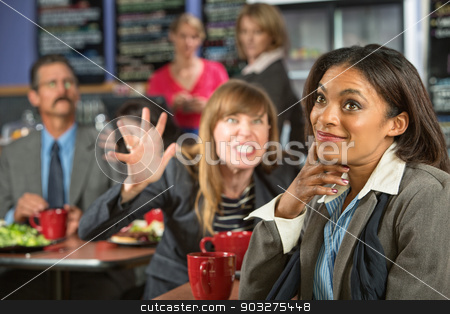 Annoyed Coworker stock photo, Annoyed coworker behind smiling business woman in cafeteria by Scott Griessel