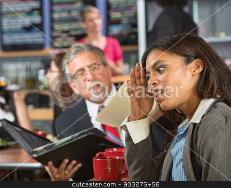 Annoyed with Boss at Lunch stock photo, Bored business woman with executive reading during lunch by Scott Griessel