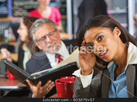 Woman Ignoring Business Man stock photo, Bored woman next to man working during lunch break by Scott Griessel