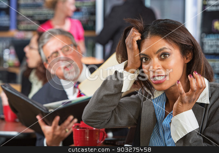 Annoyed Female Pulling Hair stock photo, Annoying business man reading to woman pulling her hair by Scott Griessel