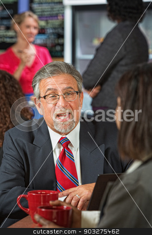 Man Talking to Coworker stock photo, Business man with beard and glasses talking to coworker by Scott Griessel