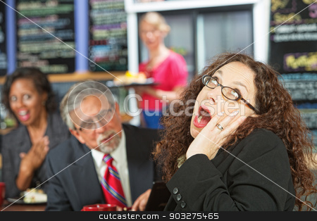 Yawning Business Woman stock photo, Business woman yawning as man talks to her during lunch by Scott Griessel