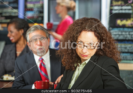 Woman Annoyed with Man stock photo, Man bothering frustrated business woman in coffee house by Scott Griessel