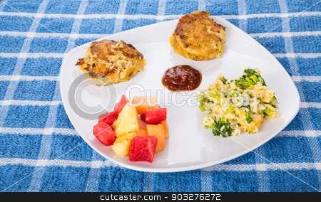 Crab Cakes with Broccoli Casserole and Fruit stock photo, Two hot crab cakes with cocktail sauce, broccoli cheese rice casserole and fresh cut fruit by Darryl Brooks